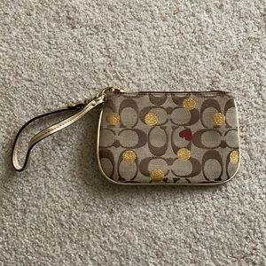 Coach heart and gold wristlet